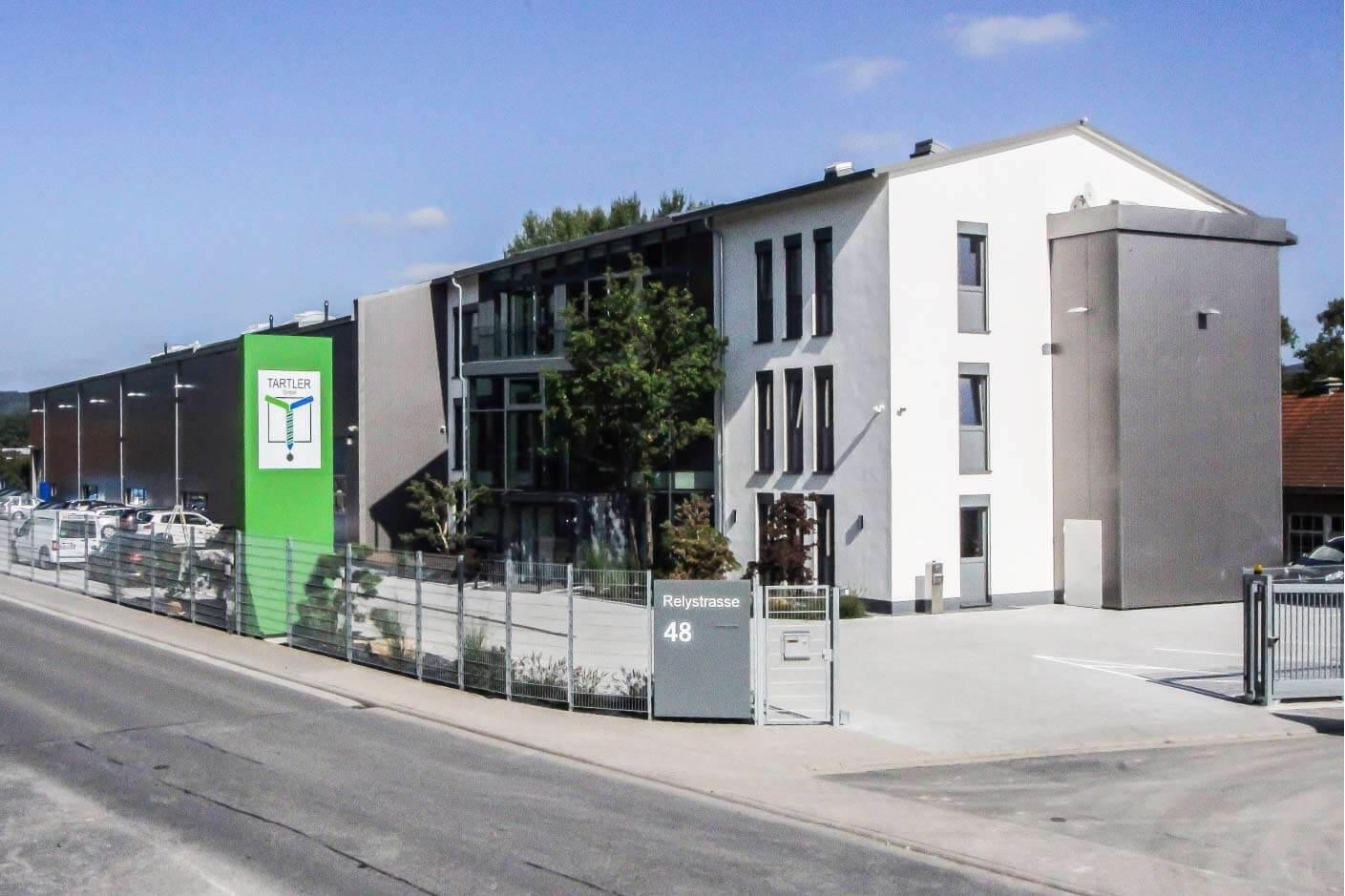 Einzug in den Hauptstandort der Verwaltung der Tartler GmbH