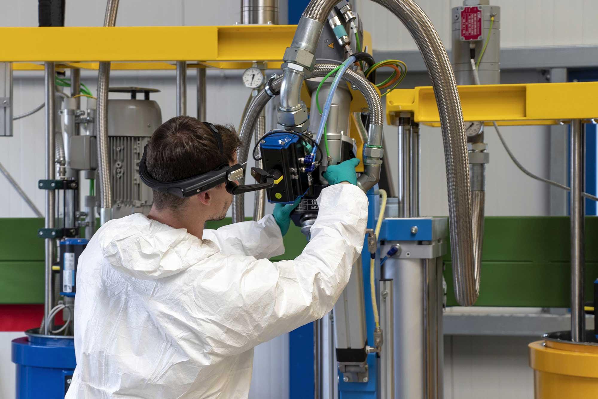 service technician shows plant via smartglass
